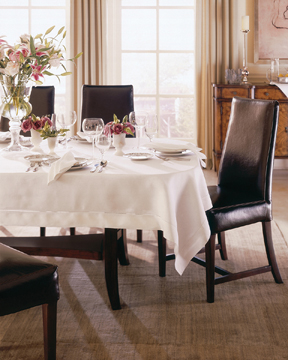 Rectangular tablecloth on oval table