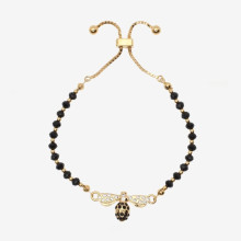 Bee Sparkle Beads Black Gold Friendship Bangle | Gracious Style