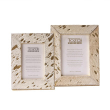 """Golden Natural Cowhide Set of Two Photo Frames with Metallic Gold Back Includes 2 Sizes: 4"""" x 6"""" and 5"""" x 7"""" (stands horizontally/vertically) - Cowhide/Glass/MDF 
